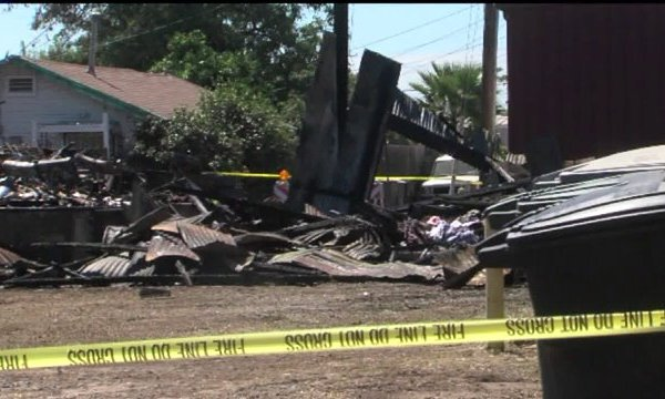 Two Riverbank Buildings Destroyed by Fire